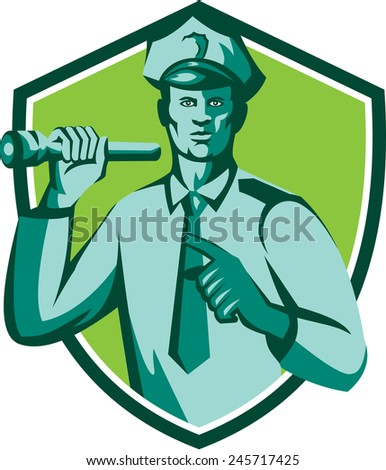 Illustration of a policeman police officer holding torch flashlight pointing facing front  set inside shield crest on isolated background done in retro style. - stock photo