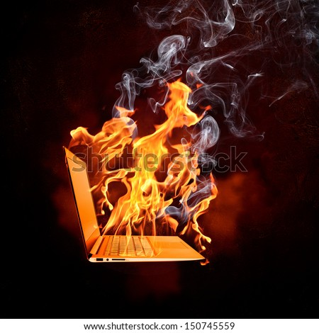 Illustration of burning laptop in fire flames - stock photo
