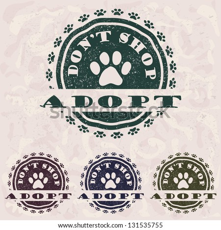 """illustration of grunge vintage pet related slogan, label, stamp with paws and text """"adopt don't shop"""" in it. - stock photo"""