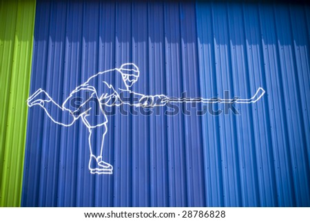 Illustration of hockey player on wall - stock photo