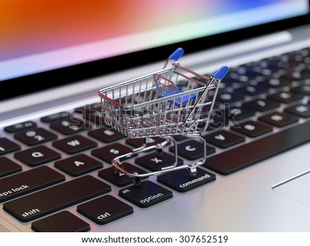 Illustration of internet shopping and online purchases concept, soft focus view of empty supermarket shopping cart on computer laptop keyboard background - stock photo