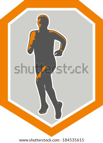Illustration of marathon triathlete runner running facing front view set inside shield crest on isolated done in retro style. - stock photo