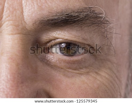 Illustration of old man eye in a close-up image - stock photo