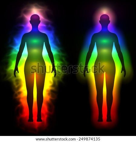 Illustration of rainbow aura of woman - silhouette - stock photo
