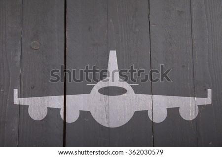 Illustration of white airplane on dark black wooden background - stock photo
