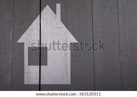 Illustration of white house on dark black wooden background - stock photo