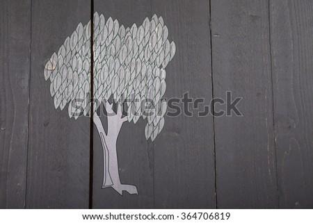 Illustration of white tree on dark black wooden background - stock photo