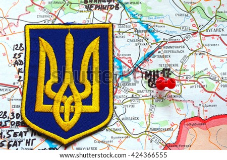 Illustrative editorial.Chevron of Ukrainian Army. Eastern Ukraine map with site of MH-17 flight crash as background. At April 25,2016 in Kiev, Ukraine - stock photo