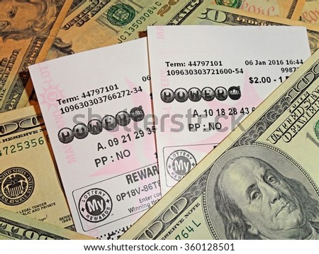 Illustrative Editorial - HAGERSTOWN, MD - JANUARY 9, 2016:  Image of Powerball lottery tickets on a US currency background. - stock photo