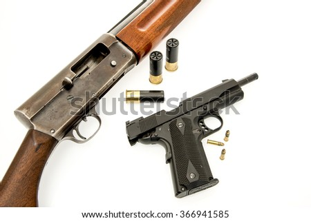 Image a shotgun and pistol with ammunition - stock photo