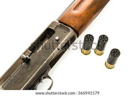 Image a shotgun with shells with an open chamber - stock photo
