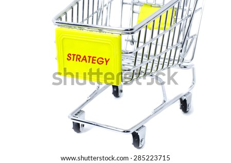 image concept cropped trolley with word strategy isolated white background - stock photo