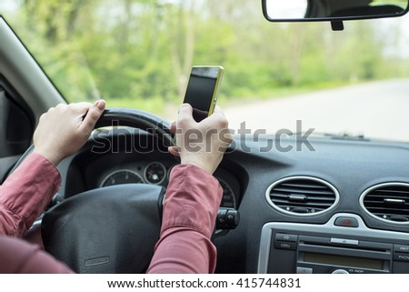 image depicting a woman riding in a car and talking on the phone - stock photo