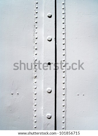 image from exterior building material texture background series (painted metal with rivets) - stock photo
