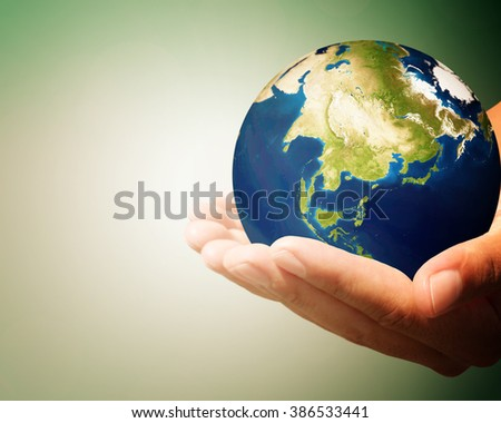 Image God created the world blurred green background.  Elements of this image furnished by NASA