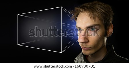Image illustrating the holographic universe theory of reality, with a man projecting his mental screen, giving him the illusion of objective reality. - stock photo