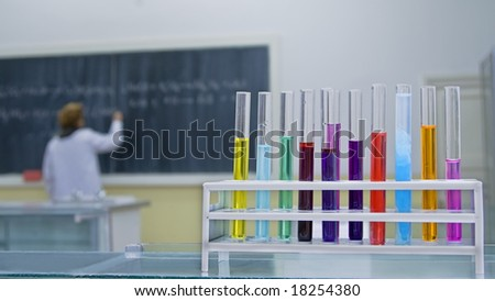 Image in a school chemistry lab.Selective focus on the tubes in foreground. - stock photo