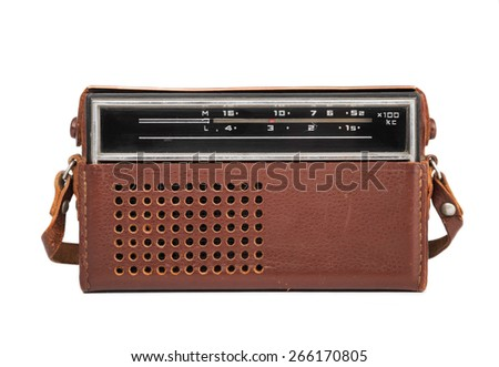 Image in close-up of an old transistor radio in a leather case isolated on white. - stock photo