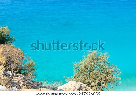 Image looking down on the clear waters  at Olu Deniz beach,  a resort on the turquoise coast of South-western Turkey, frequently voted as one of the top five beaches in the world by travellers  - stock photo