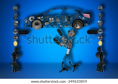 Image mechanic under the car. A set of new parts. - stock photo