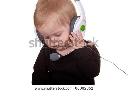 Image of a baby wearing a head set.