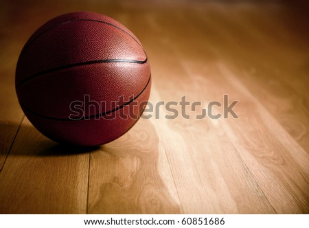 Image of a basketball lying on a wooden floor - stock photo