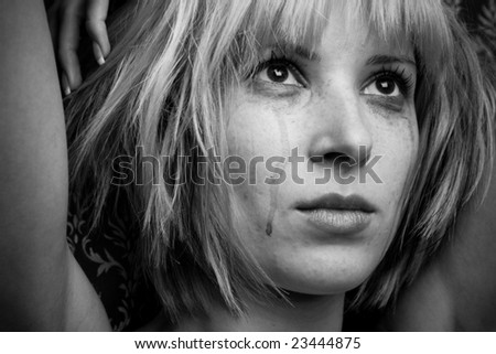 Image of a beautiful blonde in tears