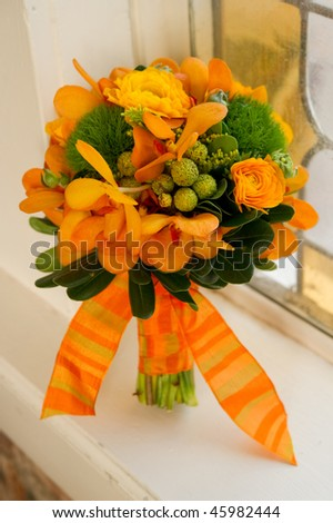 Image of a beautiful floral bouquet in window sill - stock photo
