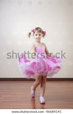 Image of a beautiful girl in a pink dress - stock photo
