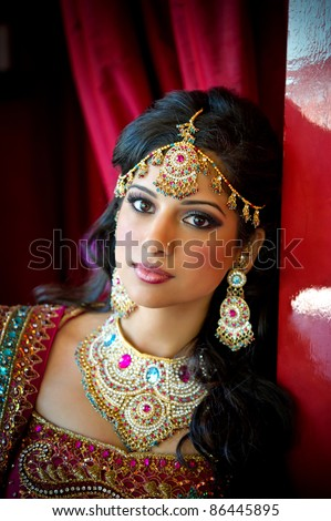 Image of a beautiful Indian bride traditionally attired - stock photo