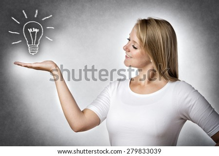 Image of a blond creative woman with an illustrated bulb - stock photo