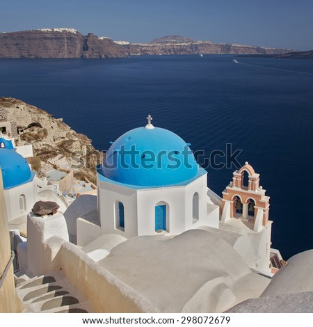 Image of a blue domed churches, popular on Santorini, Greece.