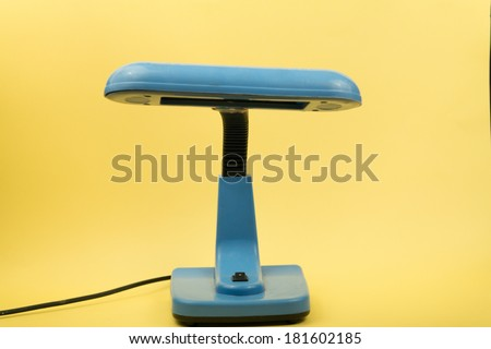 image of a blue study lamp on an isolated background - stock photo