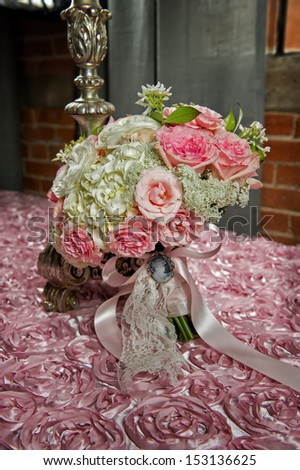 Image of a bride's wedding bouquet on a pink cloth - stock photo