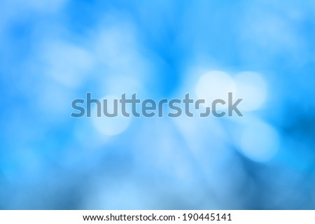 Image of a bright blue colorful bokeh background - stock photo