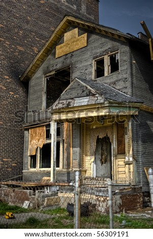 Image of a burned abandoned house in an urban neighborhood.