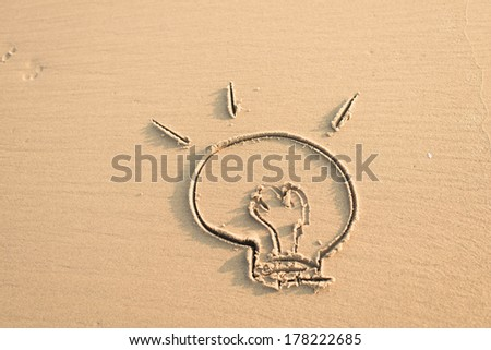 image of a burning bulb in the wet sand - stock photo