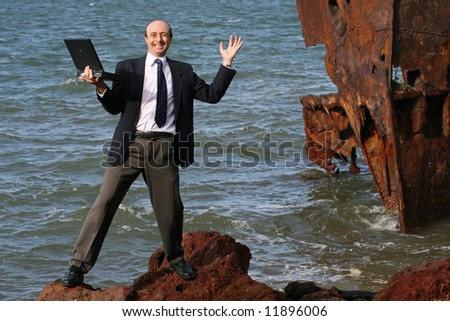 Image of a business man at a ship wreck - stock photo