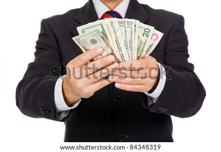 Image of a business man holding money, isolated on white
