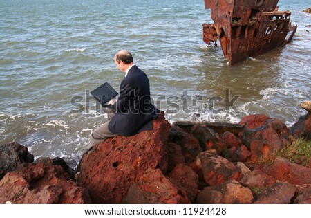 Image of a business man sitting at a wreck. - stock photo
