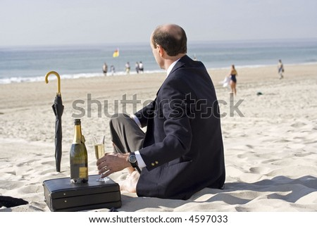 Image of a business man taking a break...or is it a drink. - stock photo