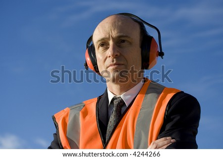 Image of a business man wearing industrial safety equipment. - stock photo