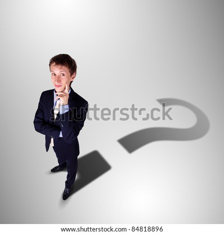 Image of a business man with a shadow shaped as a currency sign - stock photo