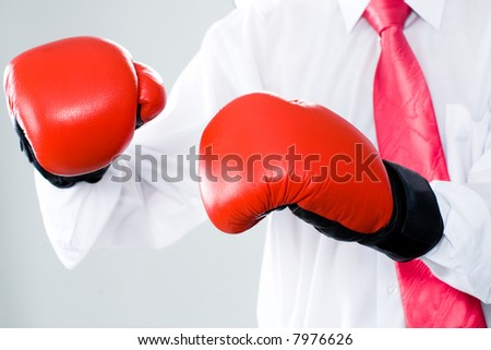 Image of a business man with red boxing gloves on a white background