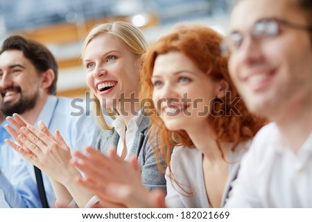 Image of a business team applauding in the sign of approval  - stock photo