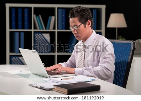 Image of a businessman concentrated at network  - stock photo