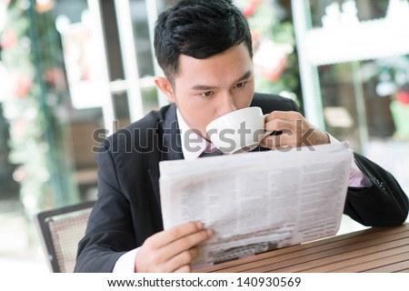 Image of a businessman having lunch outside - stock photo