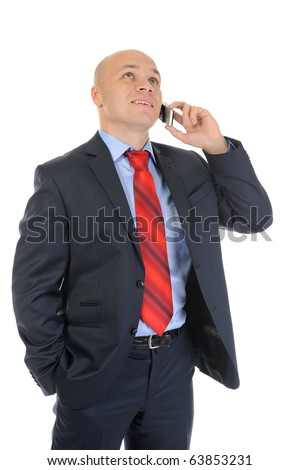 image of a businessman in a black suit with red tie, talking on the phone. Isolated on white background