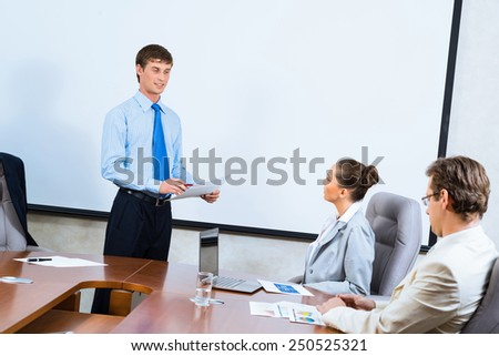 image of a businessman talking to colleagues, teamwork in the office - stock photo