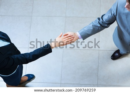 image of a businessmen hold hands together. without face